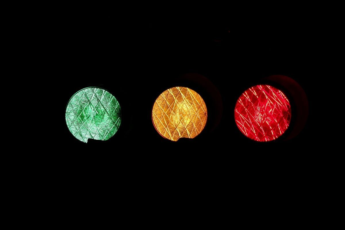 Traffic light glowing green, amber and red